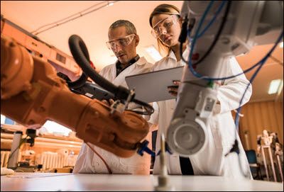 Scientists working on robotics arm
